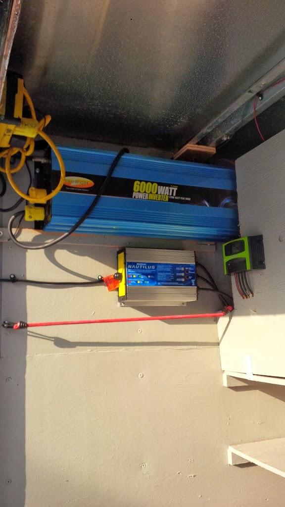 Power inverter in eavestrough trailer